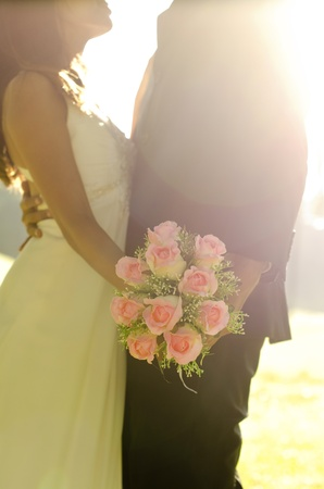 newlywed couple: Dancing bride and groom with bouquet in hand