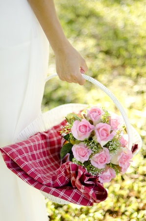 Outdoor bride holding her bouquet photo