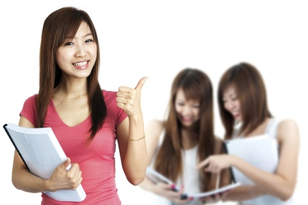 Female student thumbs up with great smile. photo