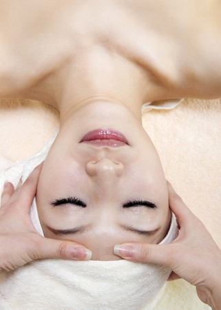 Beauty and Spa - Asian Girl having a massage on her head Stock Photo - 11111515