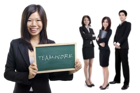 teammate: Happy smiling Asian businesswomen holding blackboard with her teammate on white background. Stock Photo