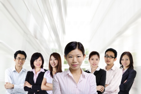 Asian business team on office background photo