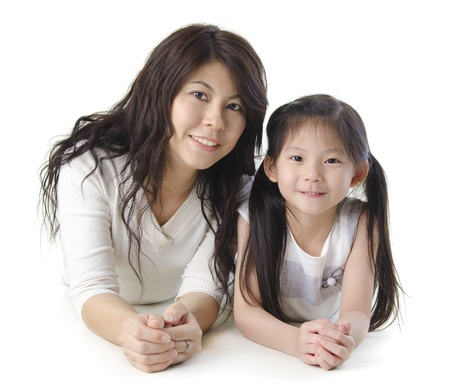 Asian mother and her daughter on white background photo