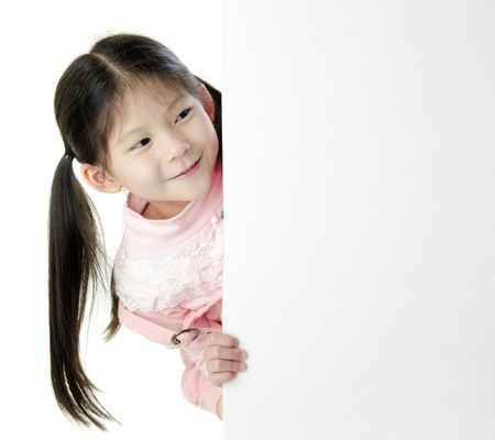 Young Asian girl holding a blank white card. photo