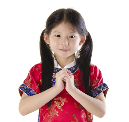 Little oriental girl wishing you a happy Chinese New Year Stock Photo - 11219176