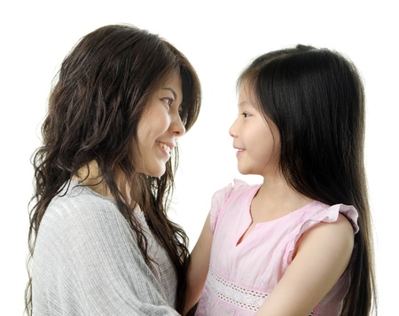 Asian mother and her daughter face to face on white background photo