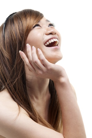 woman looking up: Laughing Asian woman looking up on white background Stock Photo