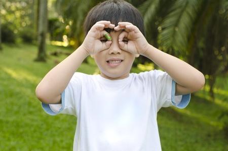 Little Asian boy having fun at outdoor park photo