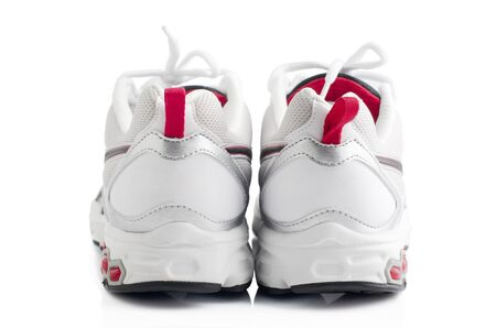 Pair of sport shoes on white background photo