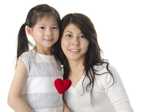 Photo of Asian mother and daughter on white background photo