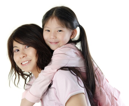 Asian mother piggyback her daughter, on white background photo