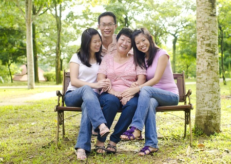 Asian family at outdoor park photo