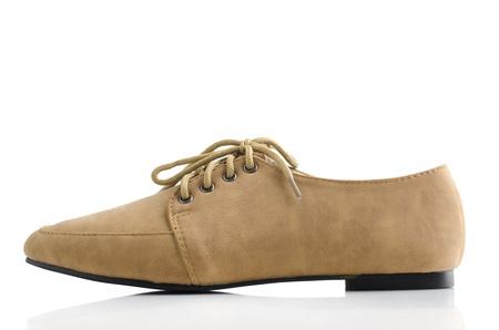 unisex: Unisex zapatos de cuero en el fondo blanco Foto de archivo