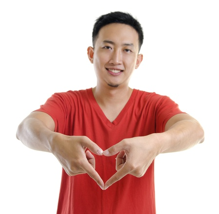 Asian young man showing love hand sign photo