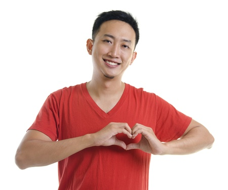 Asian young forming a heart shape on white background Stock Photo - 12386394