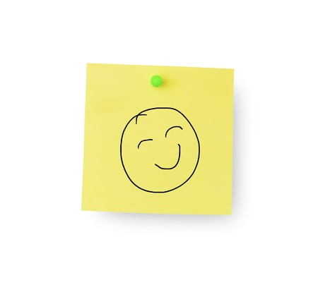 Smiley face on sticky memo notes on white background photo
