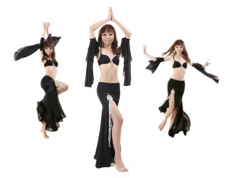 Belly dancing performance on white background photo