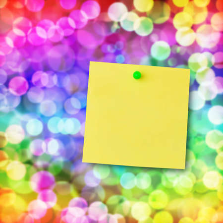 Sticky note on glowing colorful magical neon light background. photo