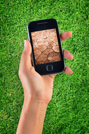 climate change: Contrast of green grass and dry soil