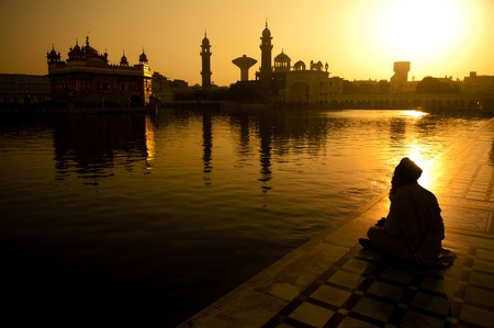 punjab: Sikh pilgrims sitting beside the holy pool,Golden Temple,Amritsar,Punjab state,India,Asia