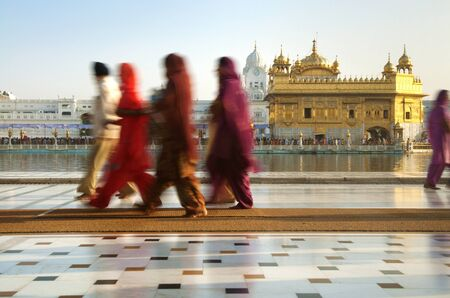 sikhism: Group of Sikh pilgrims walking by the holy pool,Golden Temple,Amritsar,Punjab state,India,Asia