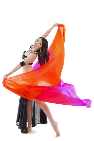 Belly dancer dancing with her veil photo