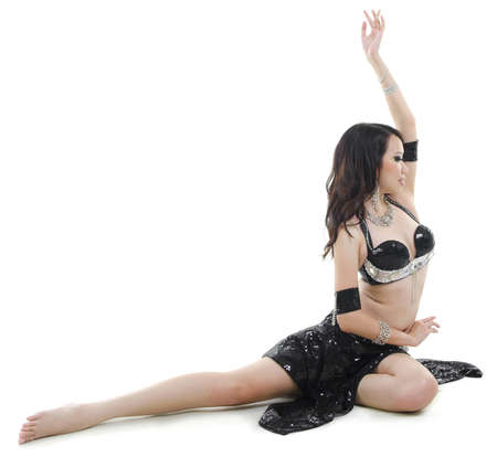Pretty Belly Dancer posing on white background photo