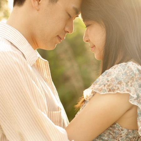 Asian couple enjoying in outdoor sunset photo