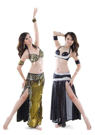 Duet belly dancer posing on white photo