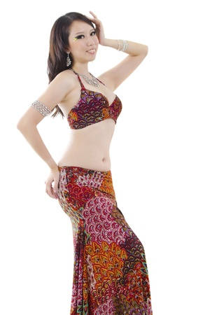 Red costume sexy belly dancer on white background photo