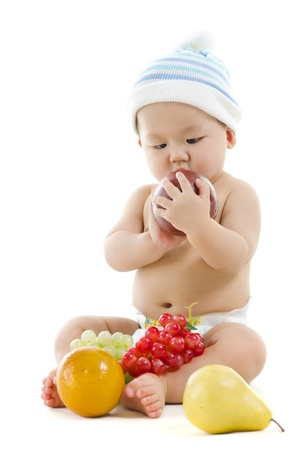 Pan Asian baby boy playing with fruits on white background Stock Photo - 12956800