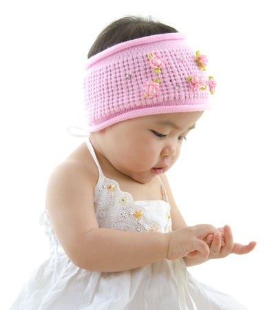 Asian baby girl playing with her hand photo