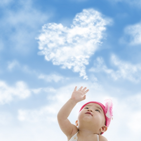 reaching out: Baby girl hand towards sky