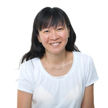 mid adult   female: Happy 40s Asian woman on white background
