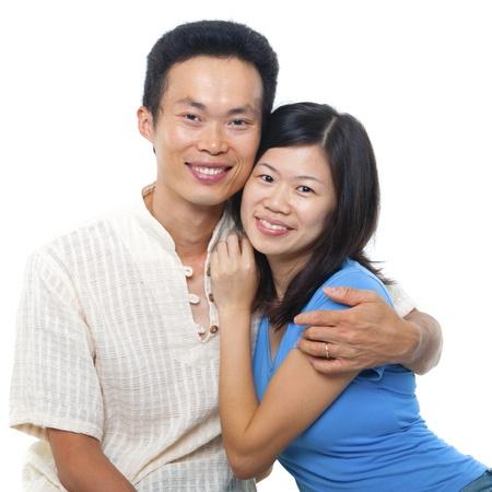 mid thirties: Loving Asian Couple on white background Stock Photo