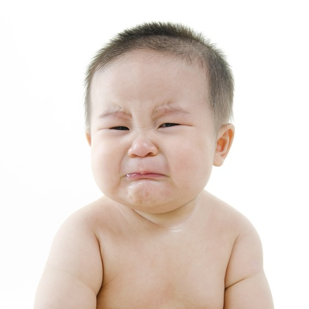 emotions faces: Crying Asian baby on white background Stock Photo