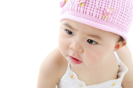 asian baby girl: Adorable pan asian baby girl on white background Stock Photo