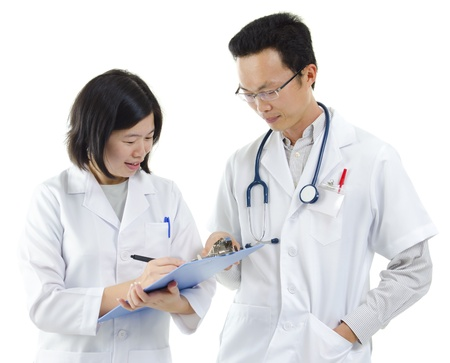 Two Asian doctor discussing, on white background photo