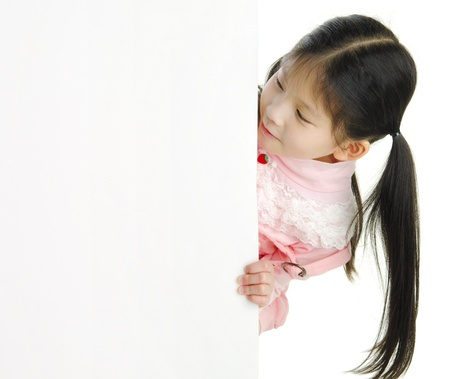 Little pan asian girl looking at white blank card photo