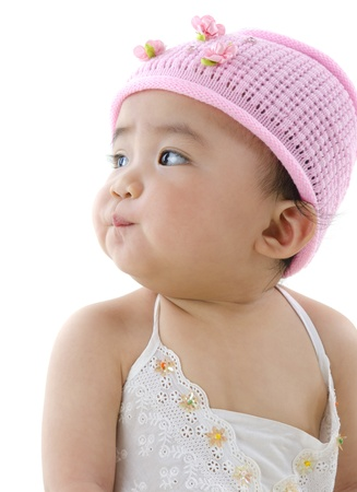 Beautiful 10 month old pan asian baby girl in pink flower hat photo