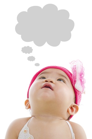 tilt: Asian baby girl looking up with thought bubble isolated on white background