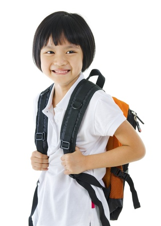 7 years old pan Asian school girl on white background photo
