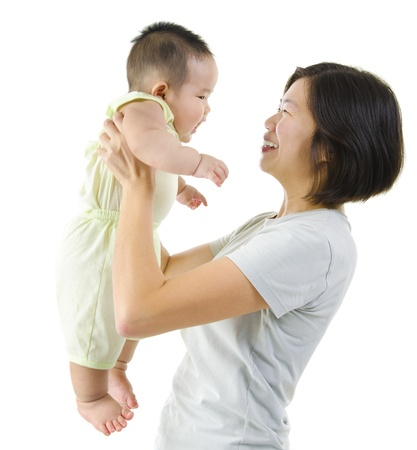 Asian mother playing with her baby boy Stock Photo - 13224757