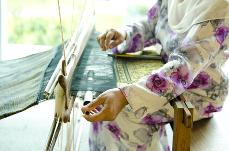 malaysian people: The process of traditional Songket weaver