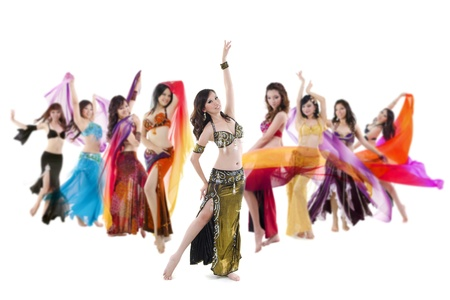 Belly dancer troupe posing on white background photo