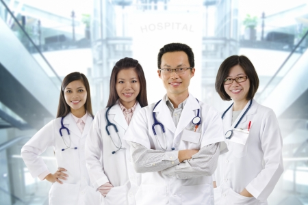 healthcare workers: Asian medical team standing inside hospital building Stock Photo