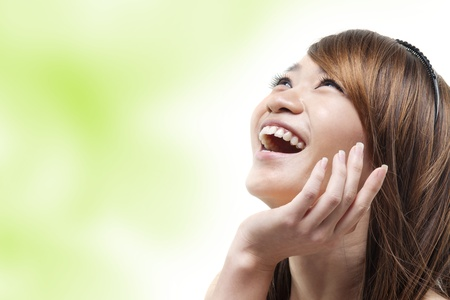 Laughing Asian woman looking up  photo