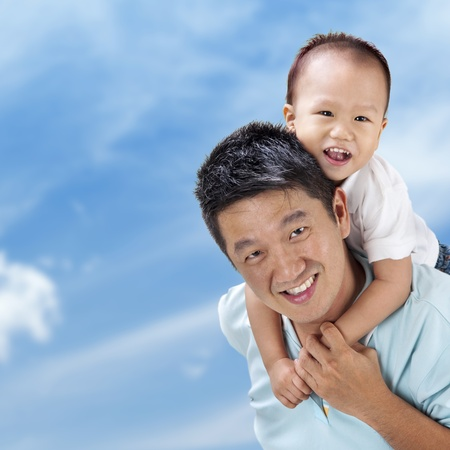 Outdoor Asian family over blue sky photo