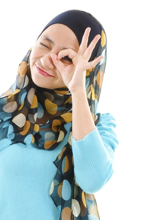observer: Young muslim woman focused by hand hole