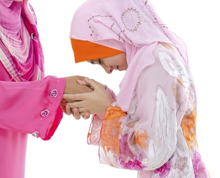 malaysian people: Young Muslim women greeting to elders